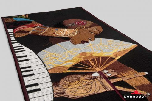 The embroidered patch African Princess with Fan lying on surface