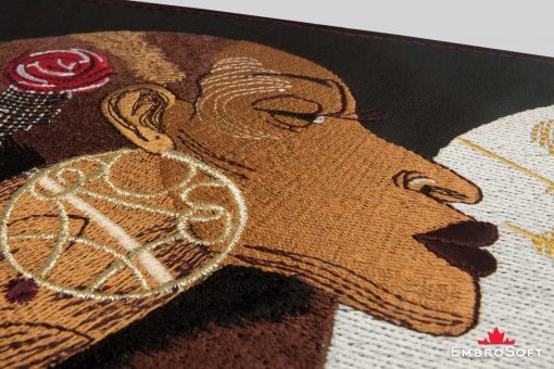 The embroidered patch African Princess with Fan - macro photo