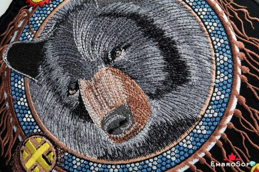 The embroidered patches Bear in Dreamcatcher turned - macro photo