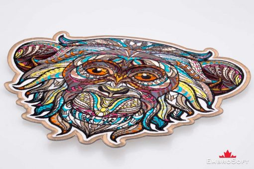 The embroidered patch Creative Monkey lying on surface