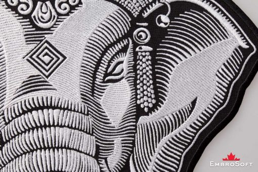 Photo close up of the embroidered patch Head of Ganesha