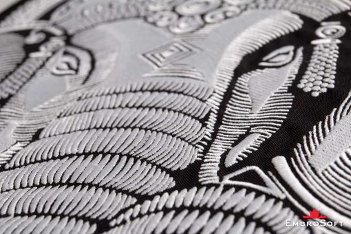 Macro photo of the embroidered patch Head of Ganesha
