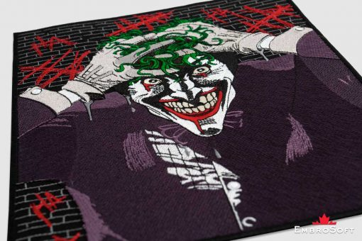 The embroidered patch Joker lying on surface