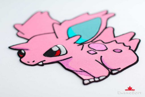 The embroidered patch Pokemon Nidoran - macro photo