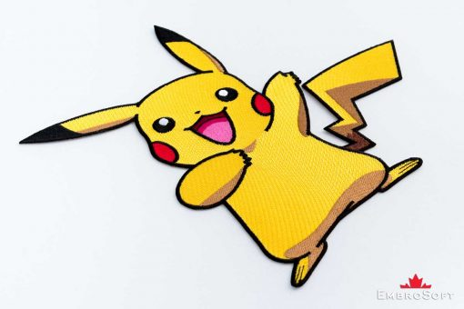 The embroidered patch Pokemon Pikachu lying on surface