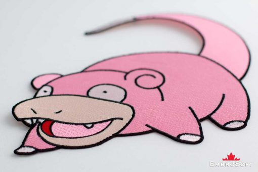 The embroidered patch Slowpoke lying on surface