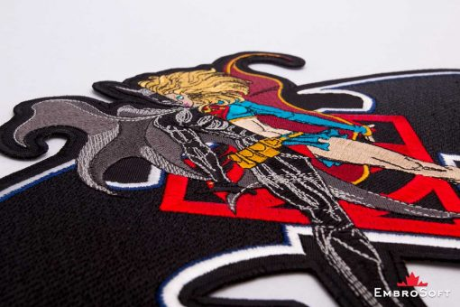The embroidered patch Super Batgirl - macro photo