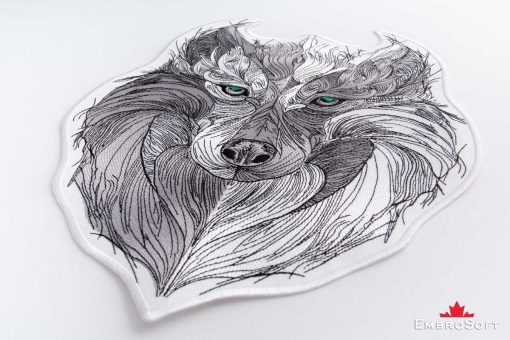 The embroidered patch Tribal Wolf with Green Eyes lying on surface