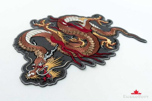 The embroidered patch Brown Dragon is lying on surface