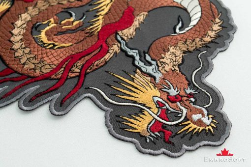 The embroidered patch Brown Dragon - macro photo