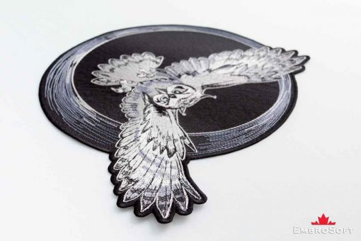 The embroidered patch Flying Owl - macro photo