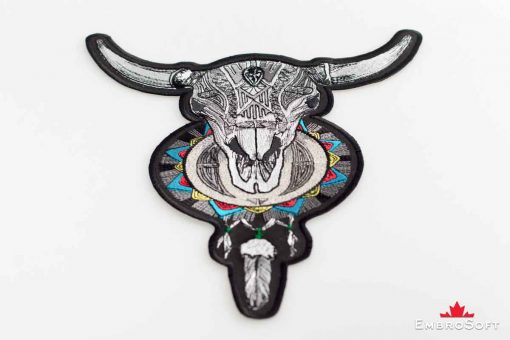 Macro picture of the embroidered patch Horned Skull with Dream Catcher