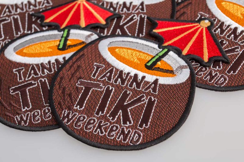 "Embroidered patch ""Tanna tiki weekend"", macro photo"