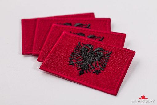 Flag Embroidered Patch of Albania Lying On Surface Collage Photo