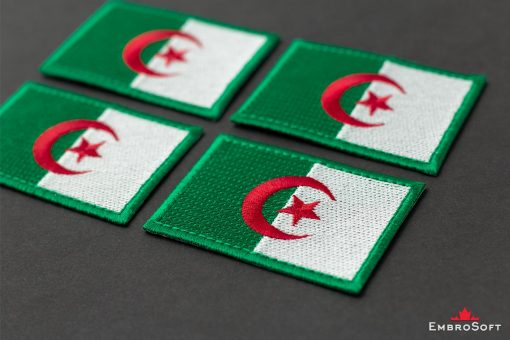Flag Embroidered Patch of Algeria Lying On Surface Photo