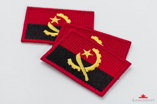Flag Embroidered Patch of Angola Lying On Surface Photo