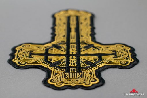 Ghost BC Grucifix Cross with Golden Pattern Lying On Surface
