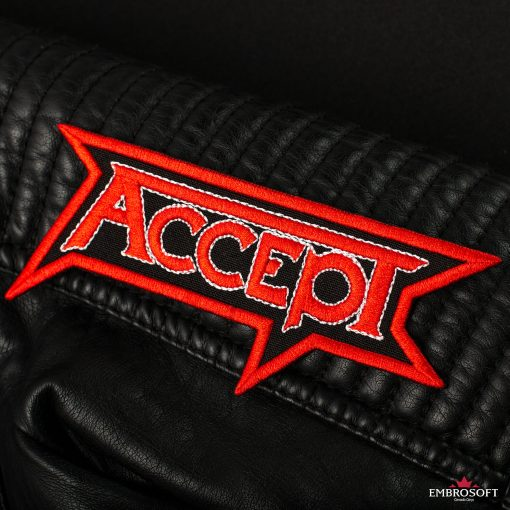 Accept heavy rock band red logo embroidered patch on a sleeve