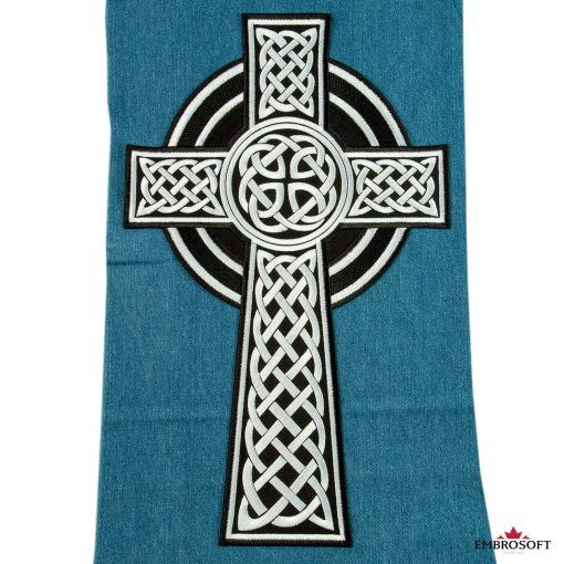 Celtic Cross emblem patch on a jeans
