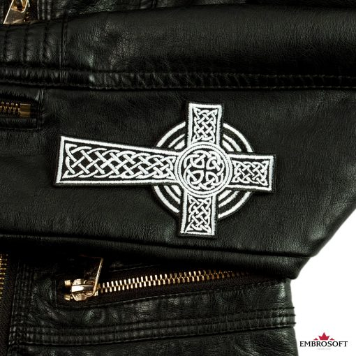 Celtic Cross embroidered patch on a leather sleeve