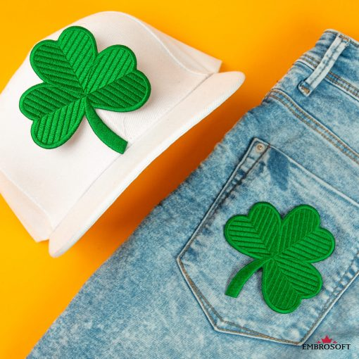 Green clover patch on a white cap and jeans