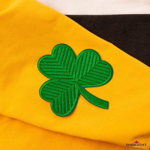 Irish Green clover patch on a yellow hoodie sleeve