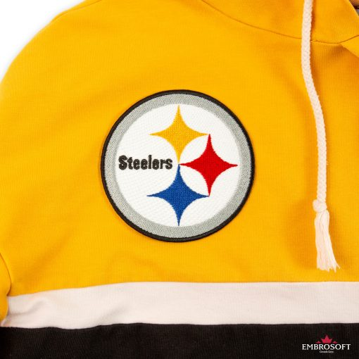 Pittsburgh Steelers logo patch on a yellow hoodie