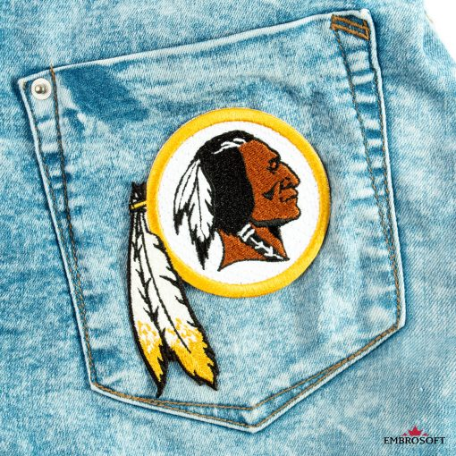 Washington Redskins patch on the back pocket of jeans