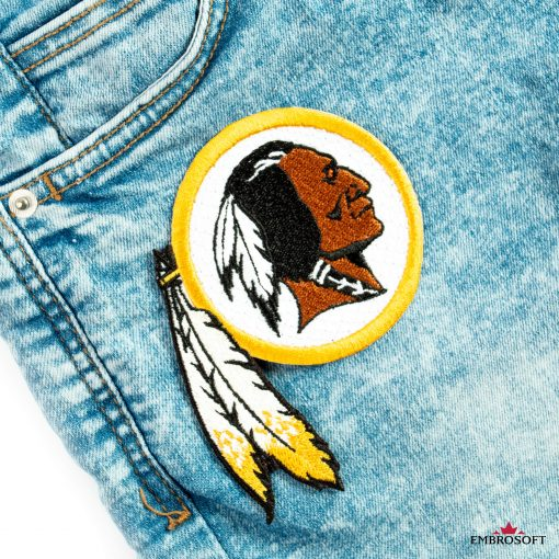 Washington redskins patch on the front pocket of jeans