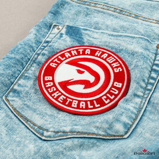 Atlanta Hawks NBA team logo patch on a back pocket jeans