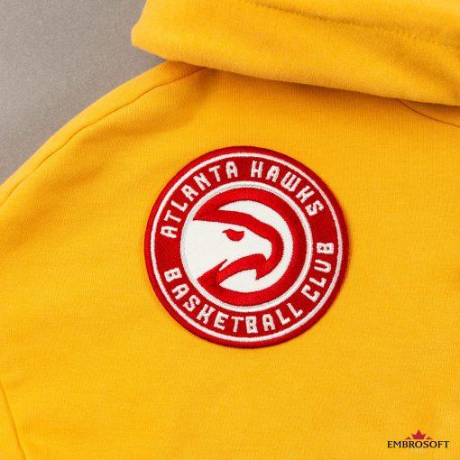 Atlanta Hawks basketball team emblem on a yellow hoody