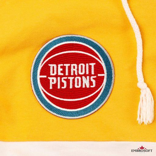Detroit Pistons NBA team logo on a yellow hoody