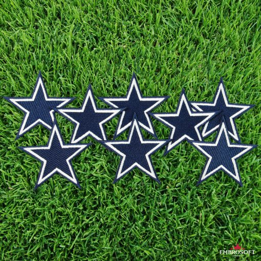 Football team logo patches Dallas Cowboys NFL grass