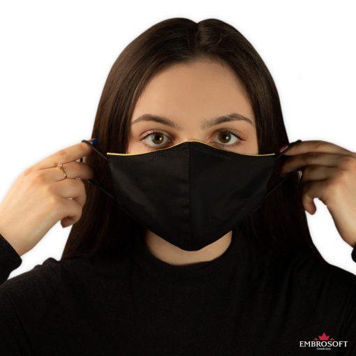 Black face mask in hands model girl