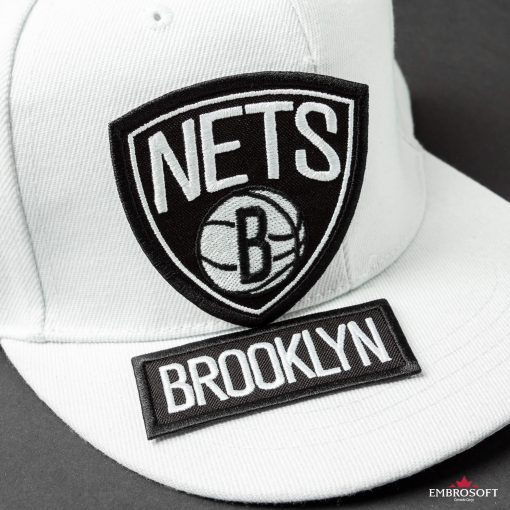 Brooklyn Nets NBA embroidered iron on patch on a white cap