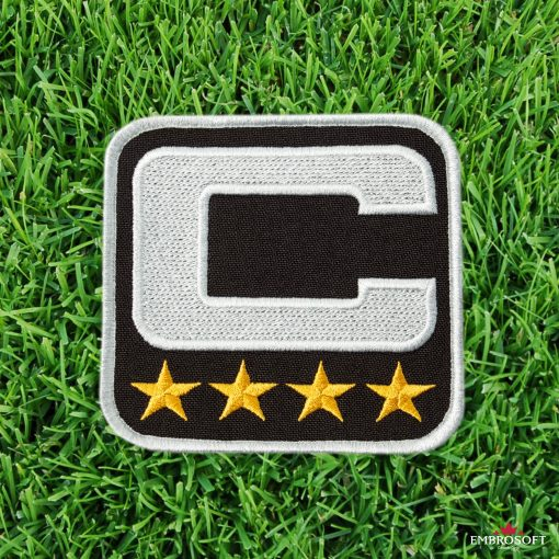NFL Captain sleeve patch on grass