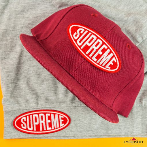 Supreme logo patch gray jacket and red cap